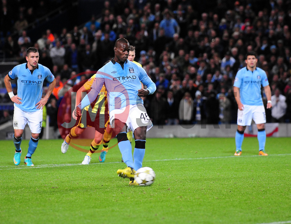 Manchester City's Mario Balotelli cooly slots home his penalty - Photo mandatory by-line: Joe Meredith/JMP  - Tel: Mobile:07966 386802 03/10/2012 - Manchester City v Borussia Dortmund - SPORT - FOOTBALL - Champions League -  Manchester   - Etihad Stadium -