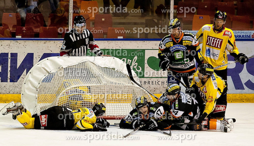 22.11.2011, Eisstadion Liebenau, Graz, AUT, EBEL, Moser Medical Graz 99ers vs UPC Vienna Capitals im Bild Reinhard Divis (UPC Vienna Capitals, #38, Goalkeeper) wird vom Tor eingeschlossen // during the Erste Bank Icehockey League, Eisstadion Liebenau, Graz, Austria, 2011-11-22, EXPA Pictures © 2011, PhotoCredit: EXPA/ E. Scheriau