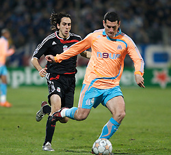 MARSEILLE, FRANCE - Tuesday, December 11, 2007: Liverpool's Yossi Benayoun and Olympique de Marseille's Julien Rodriguez during the final UEFA Champions League Group A match at the Stade Velodrome. (Photo by David Rawcliffe/Propaganda)