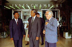 NELSON ROLIHLAHLA MANDELA (July 18, 1918 - December 5, 2013), 95, world renown civil rights activist and world leader. Mandela emerged from prison to become the first black President of South Africa in 1994. As a symbol of peacemaking, he won the 1993 Nobel Peace Prize. Joined his countries anti-apartheid movement in his 20s and then the ANC (African National Congress) in 1942. For next 20 years, he directed a campaign of peaceful, non-violent defiance against the South African government and its racist policies and for his efforts was incarcerated for 27 years. Remained strong and faithful to his cause, thru out his life, of a world of peace. Transforming the world, to make it a better place. PICTURED: NELSON MANDELA, ANC leader with JOE SLOVO (right) and bodyguard outside the Johannesburg High Court. South Africa. 1991-1993.  (Credit Image: © Greg Marinovich/ZUMA Wire/ZUMAPRESS.com)