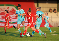 NEWPORT, WALES - Tuesday, June 12, 2018: Wales' Rachel Rowe is tackled by Russia's captain Anna Kozhnikova (left) and Anna Belomyttseva (right) during the FIFA Women's World Cup 2019 Qualifying Round Group 1 match between Wales and Russia at Newport Stadium. (Pic by David Rawcliffe/Propaganda)