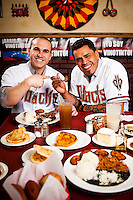 Miguel Montero and Henry Blanco pose for photos at My Arepa in Mesa, Arizona on May 25, 2012.  (Photo by Jonathan Willey/Arizona Diamondbacks)