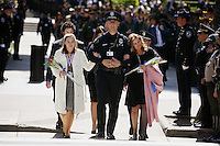 Sarah Hanson, left, daughter of slain Sgt. Scott Hanson, walks with her mother, Allison Hanson and Sgt. John Curler of the Covinia Police Department, as they arrive with other family members of last years officers who were killed in the line of duty, at the 2007 California Peace Officers Memorial ceremony next to the State Capitol, Thursday May 3, 2007.