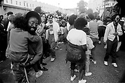 Man holding child in crowd, Notting Hill Carnival, London, 1989