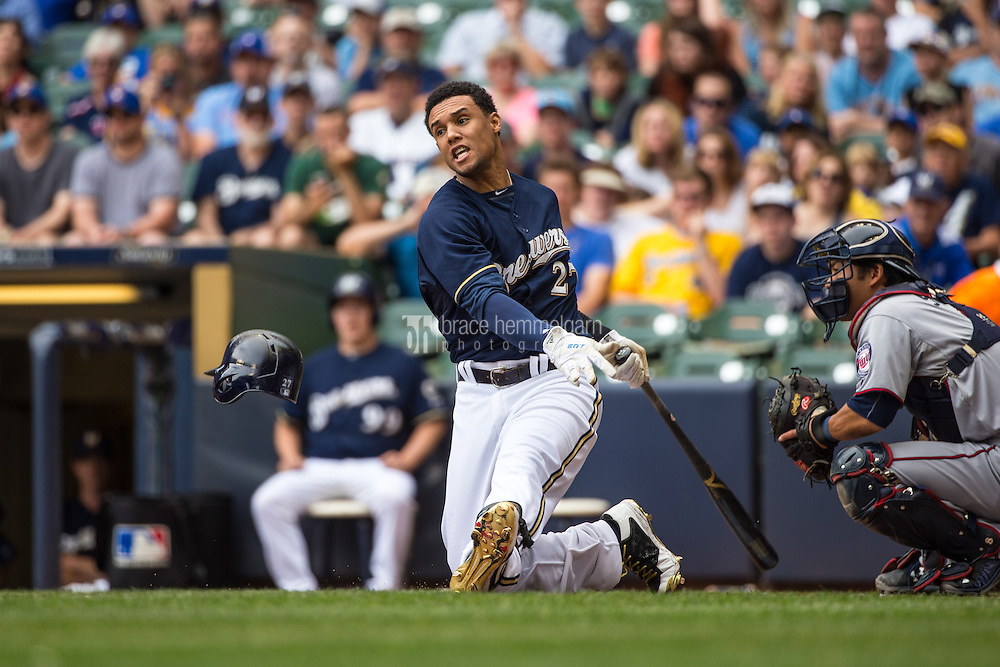 MILWAUKEE, WI- JUNE 28: Carlos Gomez #27 of the Milwaukee Brewers bats as his helmet falls off against the Minnesota Twins on June 28, 2015 at Miller Park in Milwaukee, Wisconsin. The Brewers defeated the Twins 5-3. (Photo by Brace Hemmelgarn) *** Local Caption *** Carlos Gomez