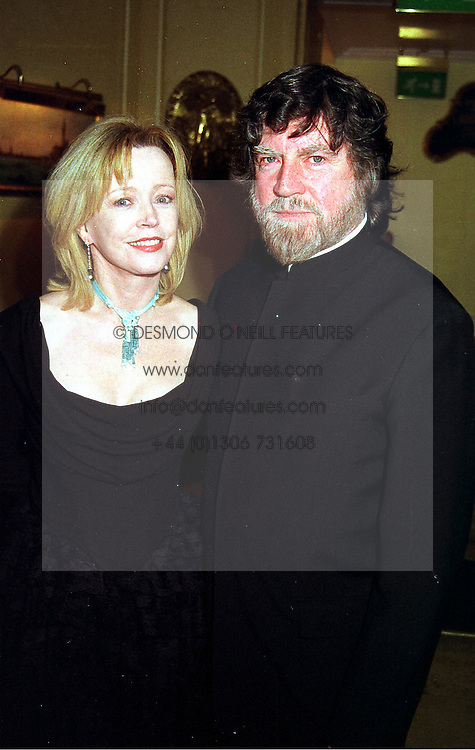 Actress ANGHARAD REES and actor ALAN BATES, at a party in London on 24th November 1999.MZH 8