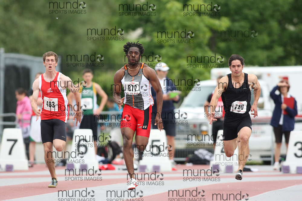 (London, Ontario---13/06/09)  \From left to right  Alex Leveque of Newfoundland & Labrador A.A. competes in the  (483)  Jamie Adjetey-Nelson of Windsor Legion T.F.C. competes in the  (877) and  Joe Dennis of South Simcoe Dufferin T.F.C competes in the  (720)\ 100m during day 1 of the decathlon at the 2009 Athletics Ontario Junior Track and Field Championships. The meet was held in London, Ontario from June 13-14, 2009. Copyright photograph Sean Burges / Mundo Sport Images, 2009. www.mundosportimages.com / www.msievents.