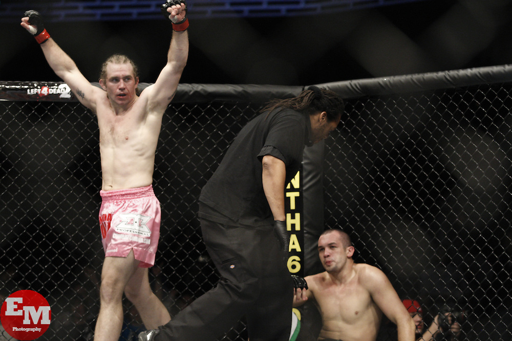 Dec 12, 2009; Memphis, TN, USA; Alan Belcher (pink trunks) celebrates after stopping Wilson Gouveia during their bout at UFC 107 at the FedEx Forum in Memphis, TN.  Belcher won via 1st round KO.