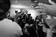 Illinois State Senator and U.S. Senate candidate Barack Obama claps along with the choir during a rally at Community Fellowship Baptist Church as campaigns on the west side of Chicago Saturday March 6, 2004. ...