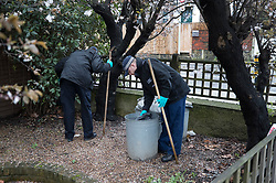 © Licensed to London News Pictures. 02/04/2018. London, UK. Members of a police search team check gardens near Ellerton Road in Wandsworth, south west London, where 20 year old Devoy Stapleton was stabbed to death at 1am on Sunday 1st April - the 31st fatal stabbing this year in the capital. It is being reported that London's murder rate has overtaken New York's.   Photo credit: Peter Macdiarmid/LNP