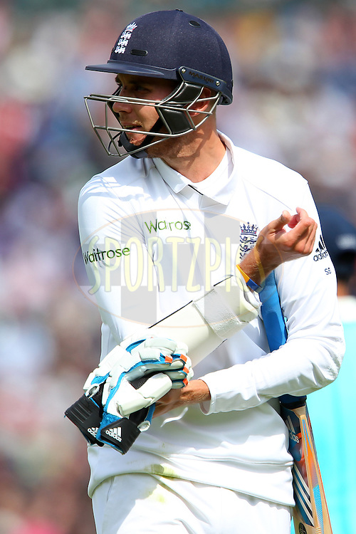 Stuart Broad of England departs during day three of the fifth Investec Test Match between England and India held at The Kia Oval cricket ground in London, England on the 17th August 2014<br /> <br /> Photo by Ron Gaunt / SPORTZPICS/ BCCI
