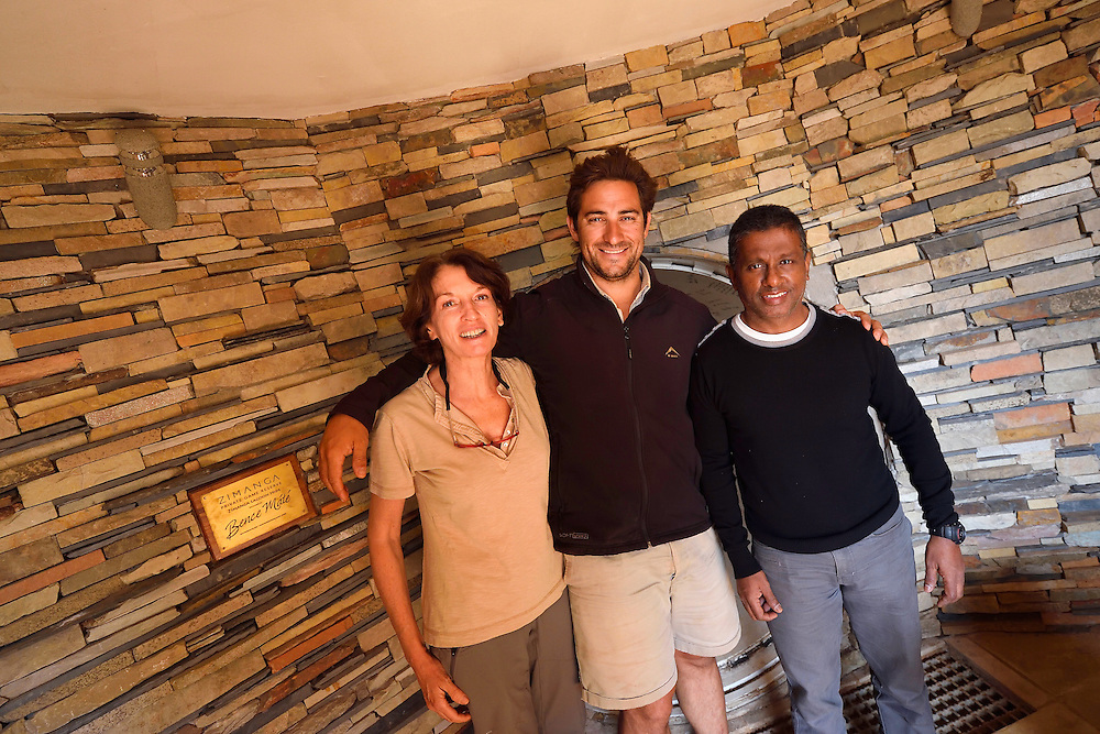 Photographers Marie-Noelle Bertiere and Ifham Raji with guide Dean Wraith, in the Lagoon hide at Zimanga Private Nature Reserve, KwaZulu Natal, South Africa