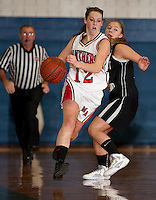 Moultonboro's Lexi Welch gets past Prospect Mountain's Hope Carazzo during Holiday Basketball Tournament action Tuesday evening at Gilford High School.  (Karen Bobotas/for the Laconia Daily Sun)