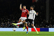 Rudy Gestede (14) of Middlesbrough battles for possession with Michael Hector (3) of Fulham during the EFL Sky Bet Championship match between Fulham and Middlesbrough at Craven Cottage, London, England on 17 January 2020.