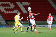 Mallik Wilks of Doncaster Rovers controls the ball with his head during the EFL Sky Bet League 1 match between Doncaster Rovers and Bristol Rovers at the Keepmoat Stadium, Doncaster, England on 26 March 2019.