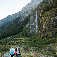 The Rob Roy Glacier Track leads hikers through a beech forest into a basin underneath the Rob Roy Glacier with waterfalls and views of Mount Aspiring near Wanaka on the South Island of New Zealand.