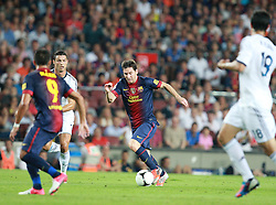 Lionel Messi attacks for Barcelona and skips past his rival Cristiano Ronaldo.  Barcelona v Real Madrid, Supercopa first leg, Camp Nou, Barcelona, 23rd August 2012...Credit - Eoin Mundow/Cleva Media.