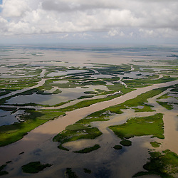 Canals created for navigation and oil and gas pipelines are seen in marsh over the coast of Louisiana, U.S., on Monday, July 26, 2010. Photographer: Derick E. Hingle/Bloomberg