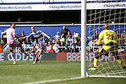 Queens Park Rangers forward Sebastian Polter (33) has a shot on goal during the Sky Bet Championship match between Queens Park Rangers and Reading at the Loftus Road Stadium, London, England on 23 April 2016. Photo by Andy Walter.