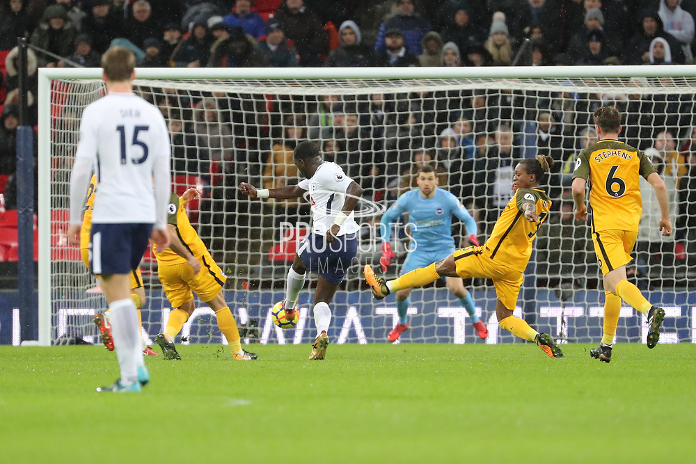 Moussa Sissoko of Tottenham Hotspur (17) with a shot on goal during the Premier League match between Tottenham Hotspur and Brighton and Hove Albion at Wembley Stadium, London, England on 13 December 2017. Photo by Matthew Redman.