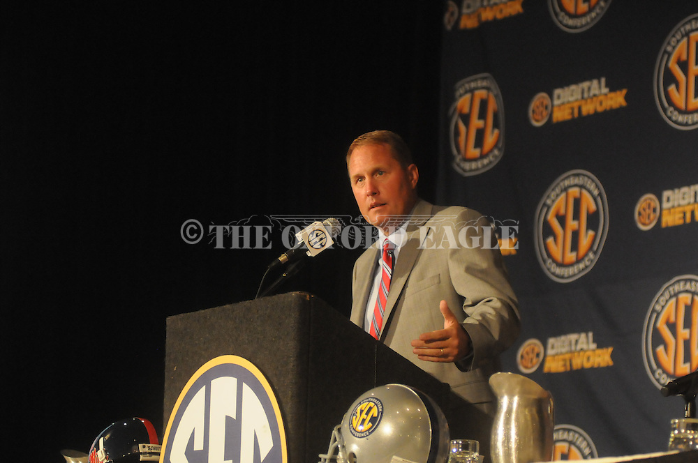 Mississippi coach Hugh Freeze talks with reporters during the SEC football Media Days in Hoover, Ala., Tuesday, July 16, 2013.