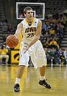 January 12 2010: Iowa Hawkeyes guard/forward Eric May (25) passes the ball during the first half of an NCAA college basketball game at Carver-Hawkeye Arena in Iowa City, Iowa on January 12, 2010. Northwestern defeated Iowa 90-71.