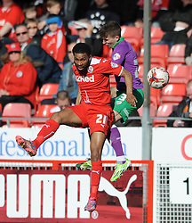 Bristol City's Joe Bryan challenges for the header with Crawley's Gavin Tomlin - Photo mandatory by-line: Dougie Allward/JMP - Mobile: 07966 386802 - 07/03/2015 - SPORT - Football - Crawley - Broadfield Stadium - Crawley Town v Bristol City - Sky Bet League One