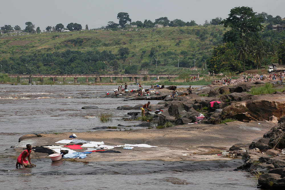 People washing clothes in the Congo river from the Gombe neighbourhood. Kinshasa, Democratic Republic of Congo...Zute & Demelza Lightfoot.www.lightfootphoto.com
