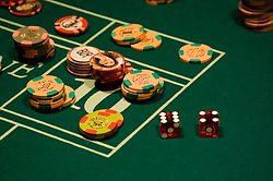 Dice and chips on a craps table in Las Vegas Nevada, Caesars Palace and Casino, gaming, gambling, craps, craps table, dice, die, NV, Las Vegas, Photo nv222-16904..Copyright: Lee Foster, www.fostertravel.com, 510-549-2202,lee@fostertravel.com