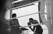 Ali vs Lewis Fight, Croke Park,Dublin.<br /> 1972.<br /> 19.07.1972.<br /> 07.19.1972.<br /> 19th July 1972.<br /> As part of his built up for a World Championship attempt against the current champion, 'Smokin' Joe Frazier,Muhammad Ali fought Al 'Blue' Lewis at Croke Park,Dublin,Ireland. Muhammad Ali won the fight with a TKO when the fight was stopped in the eleventh round.<br /> <br /> Image of Lewis as he comes in low to attack Ali.
