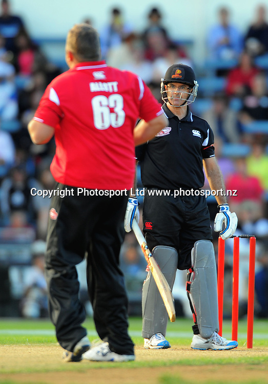 Bruce Edgar glares at bowler Geoff Allott after a bouncer. Fill The Basin for Christchurch fundraising cricket match - Canterbury Invitational XI v Wellington Legends XI  at Hawkins Basin Reserve, Wellington, New Zealand on Sunday, 13 March 2011. Photo: Dave Lintott / lintottphoto.co.nz