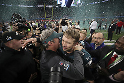 February 4, 2018 - Minneapolis, MN, USA - Philadelphia Eagles coach Doug Pederson, left, embraces Eagles quarterback Nick Foles after their team won Super Bowl LII against the New England Patriots on Sunday, Feb. 4, 2018, in Minneapolis, Minn. Foles was named the game's MVP. He took over as the Eagles starter after Carson Wentz went out late in the season with a knee injury. (Credit Image: © Jerry Holt/TNS via ZUMA Wire)