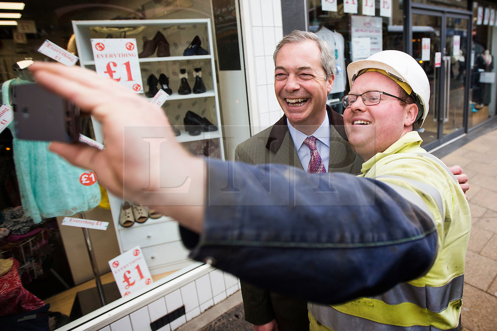 © Licensed to London News Pictures. 18/04/2016. Sheffield UK. Picture shows Nigel Farage posing for a selfie with a workman in Sheffield. Nigel Farage has been in sheffield today to support Steve Winstone's campaign in the Sheffield Brightside & Hillsborough by election. Photo credit: Andrew McCaren/LNP