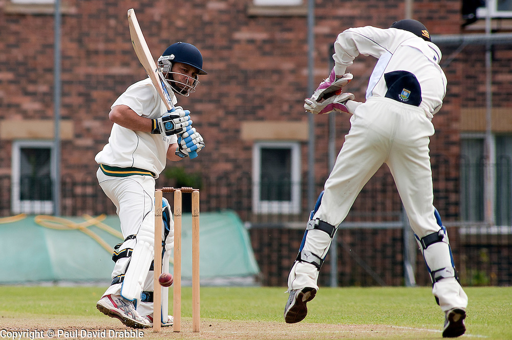 Cricket Wickersley v Whitley Hall,  Wickersley No 2 batsman  Headir Jounger and whitley hall wickett keeper Tom Soresby..12  May 2012.Image © Paul David Drabble