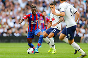 Crystal Palace forward Wilfried Zaha (11) on the ball goes towards the goal during the Premier League match between Tottenham Hotspur and Crystal Palace at Tottenham Hotspur Stadium, London, United Kingdom on 14 September 2019.