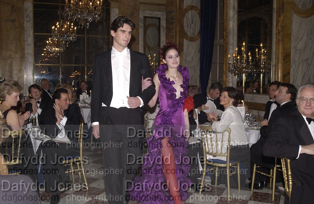 Alexis Tennessee Hamilton and her escort, Cesar Darcy. . Crillon Debutantes Ball 2002. Paris. 7 December 2002. © Copyright Photograph by Dafydd Jones 66 Stockwell Park Rd. London SW9 0DA Tel 020 7733 0108 www.dafjones.com