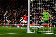 Alex Oxlade-Chamberlain of Arsenal (centre) scores his team's third goal against R.S.C Anderlecht to make it 3-0 during the UEFA Champions League match at the Emirates Stadium, London<br /> Picture by David Horn/Focus Images Ltd +44 7545 970036<br /> 04/11/2014