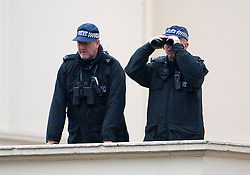 © London News Pictures. 09/05/2012. London, UK.  Police with binoculars watch preparations for the Opening of Parliament on May 09, 2012 in London. In a speech to Members of Parliament and Peers in The House of Lords, Queen Elizabeth II will officially open a new session of parliament, which will set out the government's agenda and legislation for the coming year. Photo credit: Ben Cawthra/LNP