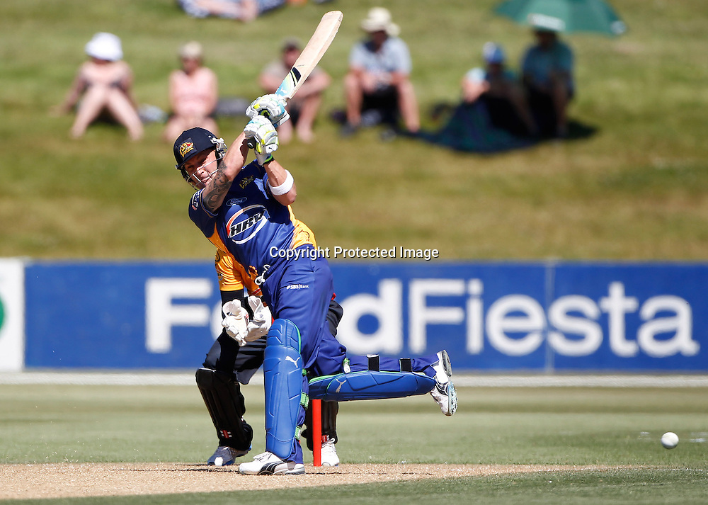 Brendon Mcullum hits out during the Twenty20 Cricket - HRV Cup, Otago Volts v Wellington Firebirds, Saturday 31 December 2011, Queenstown Events Centre, Queenstown, New Zealand. Photo: Michael Thomas/photosport.co.nz