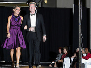 Community role models Kimberly Robinson (left) and Greg Robinson on the runway during the 23rd Annual Bravo! Fashion Show at the Sinclair Conference Center in downtown Dayton, Friday, October 1, 2010.