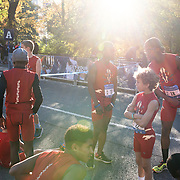 NYTRUN - NOV. 6, 2016 - NEW YORK - Members of the Chelsea Greyhonds warm up on East Drive ahead of the NYRR Youth Invitational near East 86th Street in Central Park in Manhattan on Sunday morning. NYTCREDIT:  Karsten Moran for The New York Times **CAMERA EXIF TIME -60min