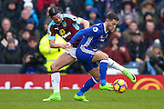 Burnley midfielder George Boyd (21) tries to tackle Chelsea midfielder Eden Hazard (10)  during the Premier League match between Burnley and Chelsea at Turf Moor, Burnley, England on 12 February 2017. Photo by Simon Davies.