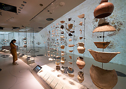 Ancient pottery on display at  the new National Museum of Qatar in Doha , Qatar. Architect Jean Nouvel.