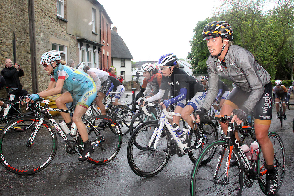 ©Licensed to London News Pictures. 08/05/2014<br /> Wollaston, Northamptonshire. Stage 2 of the Friends Life Women's Cycle Tour of Britain rides through the pooring rain of Northamptonshire on its way to Bedford.<br /> Photo credit: Steven Prouse/ LNP