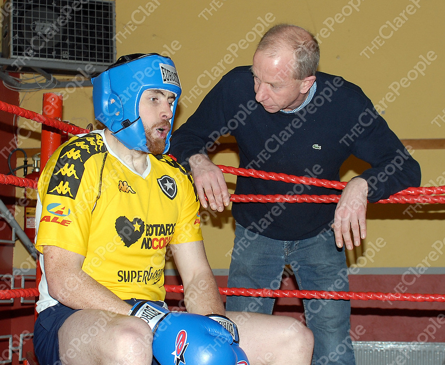 Mark Fitzgerald takes advice from cornerman, Tony Hurson during training for the Clare Conquest white collar boxing tournament.