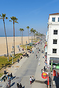 Tourists on Venice Beach Boardwalk Looking North Towards Santa Monica
