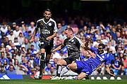 Chelsea Midfielder Pedro (17) tackles Leicester City Midfielder Danny Drinkwater (4) during the Barclays Premier League match between Chelsea and Leicester City at Stamford Bridge, London, England on 15 May 2016. Photo by Jon Bromley.