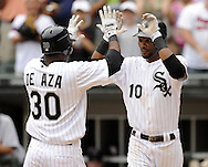 CHICAGO - JULY 27:  Alejandro De Aza #30 is greeted at home plate by Alexei Ramirez #10 of the Chicago White Sox after De Aza hit a two-run home run in the second inning against the Detroit Tigers on July 27, 2011 at U.S. Cellular Field in Chicago, Illinois.  The White Sox defeated the Tigers 2-1.  (Photo by Ron Vesely)  Subject: Alejandro De Aza;Alexei Ramirez