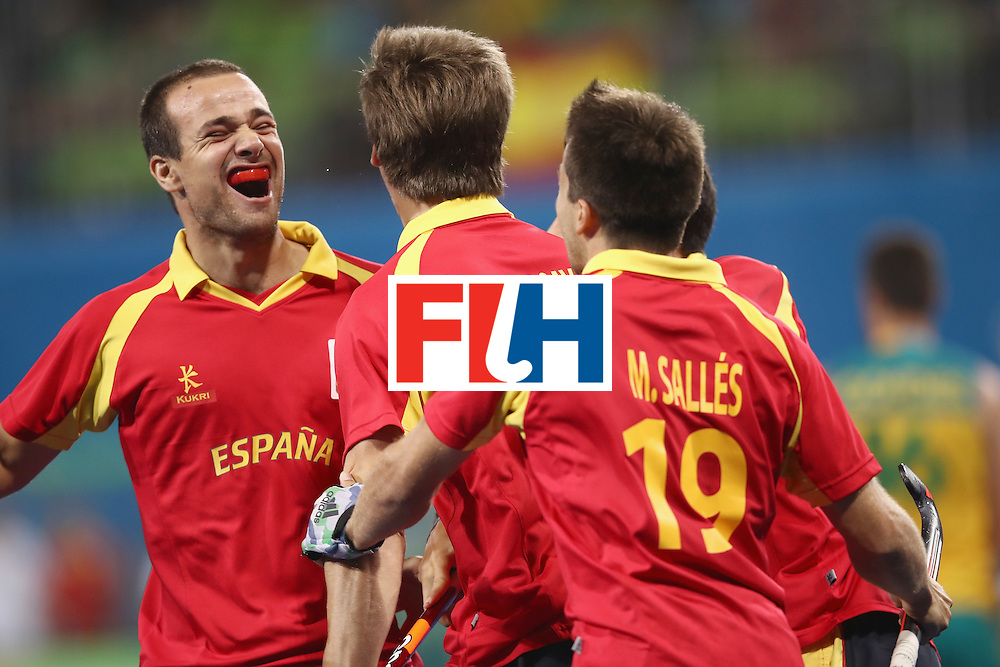 RIO DE JANEIRO, BRAZIL - AUGUST 07:  Alvaro Iglesias of Spain celebrates with Alex Casasayas of Spain after he scored a goal during the men's pool A match between Spain and Australia on Day 2 of the Rio 2016 Olympic Games at the Olympic Hockey Centre on August 7, 2016 in Rio de Janeiro, Brazil.  (Photo by Mark Kolbe/Getty Images)