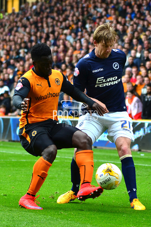 Dan Harding clears the ball from Nouha Dicko during the Sky Bet Championship match between Wolverhampton Wanderers and Millwall at Molineux, Wolverhampton, England on 2 May 2015. Photo by Alan Franklin.